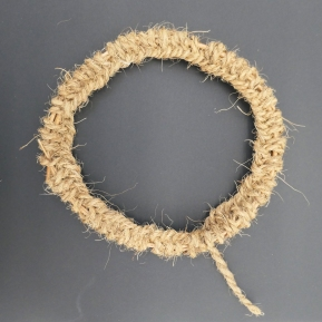 A looped a coarse fibre rope around the ring